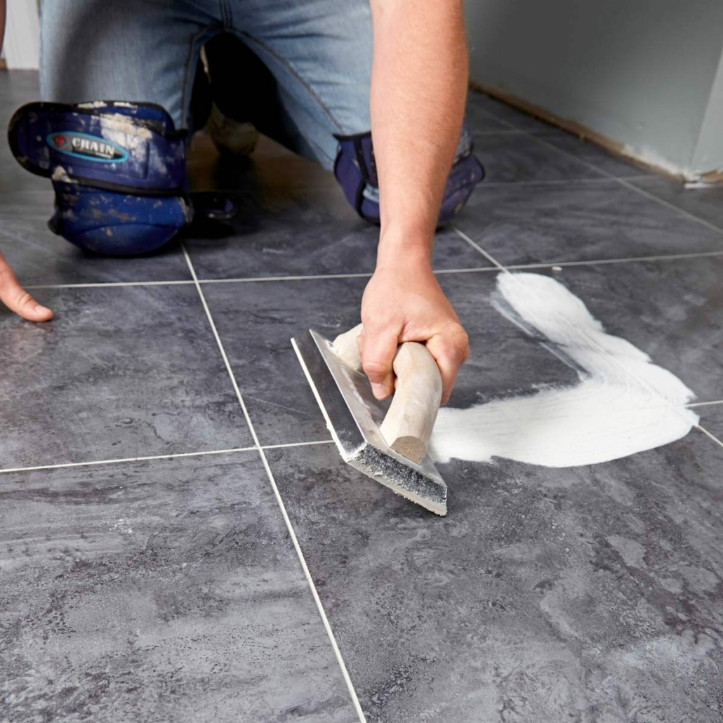 Contractor Installing Luxury Vinyl Tile